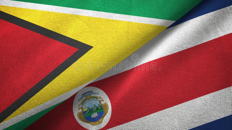 Guyana and Costa Rica two flags textile cloth, fabric texture vector illustration