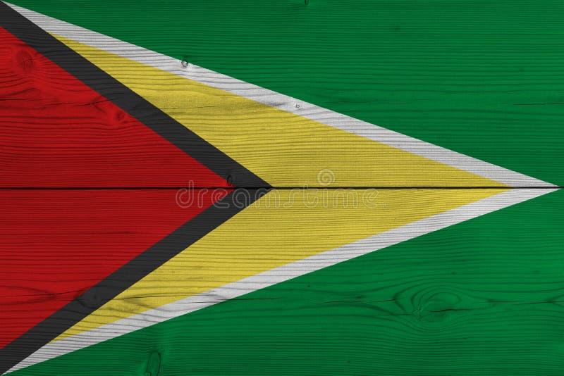 Guyana-Flagge gemalt auf alter hölzerner Planke stock abbildung