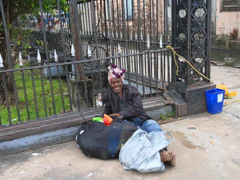 Guyana, Georgetown: A Homeless Man - Poor and Happy? royalty free stock photos