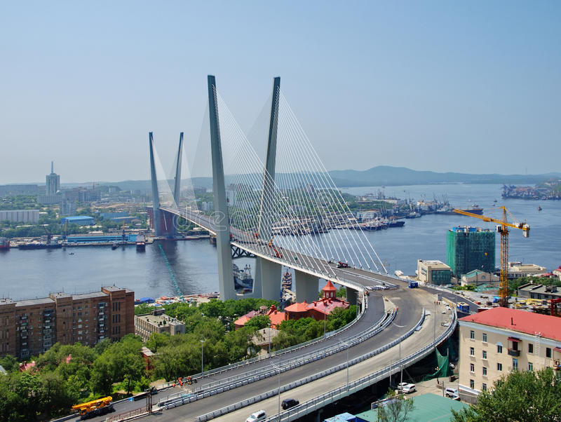 Guyed bridge in the Vladivostok. Big guyed bridge in the Vladivostok over the Golden Horn bay, Russian royalty free stock image