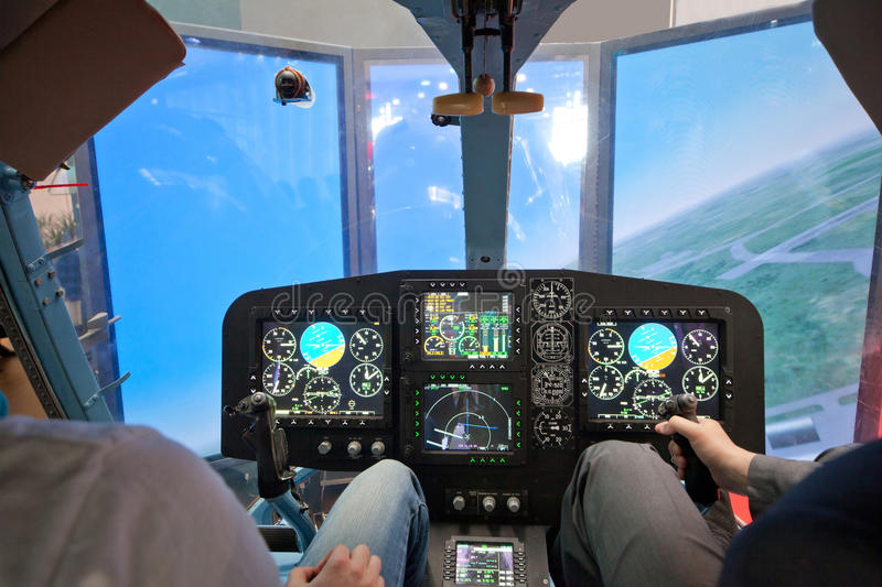 Guys flying on helicopter simulator stock photos