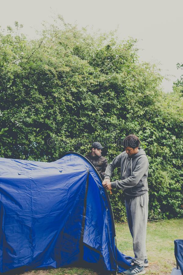 Guys pitching tent camping outdoor royalty free stock photography