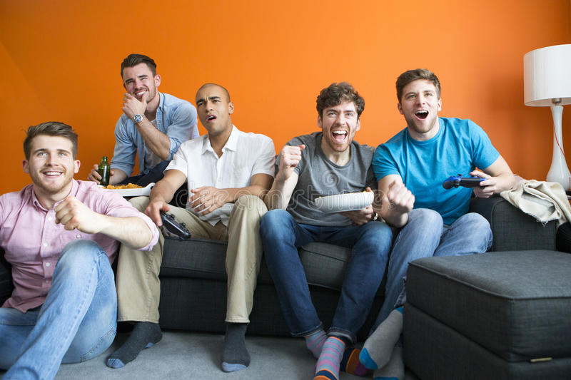 Download Guys playing video games stock photo. Image of expression - 72930896