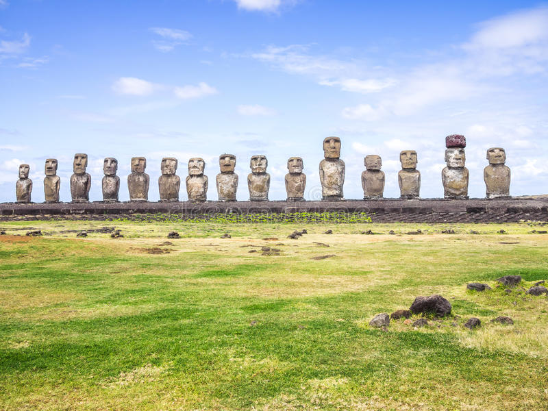 The guys in Tongariki. The sacred Ahu Tongariki is the most impressive reunion of moais in Easter Island royalty free stock photography