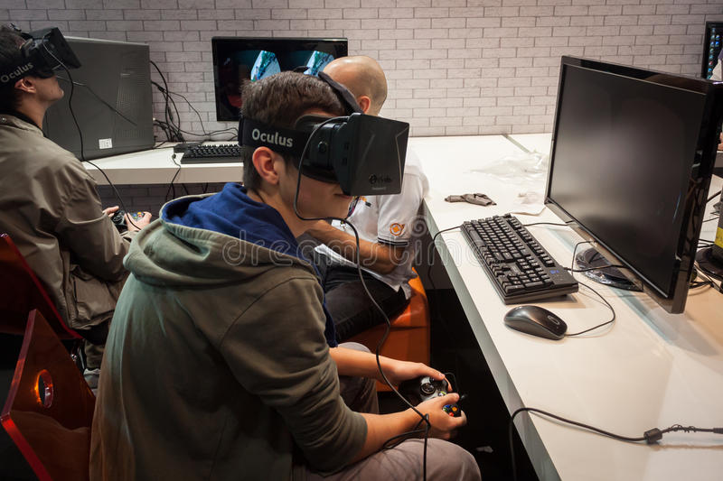 Guys try a virtual reality headset at Games Week 2013 in Milan, Italy stock image