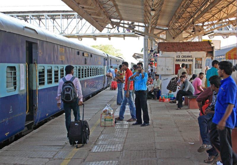Travellers waiting train, India stock image