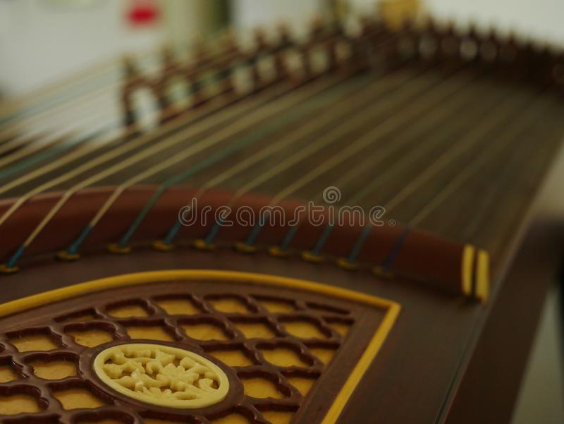 Guzheng with blurred strings musical instrument stock photo