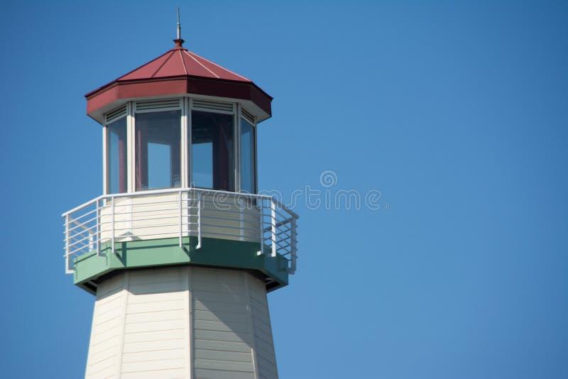 Navy Lighthouse over blue sky royalty free stock photography