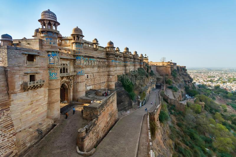 GWALIOR, INDIA - MARCH 22 2017: Indian fort in Madhya Pradesh at. Daylight with some people on the road stock photos