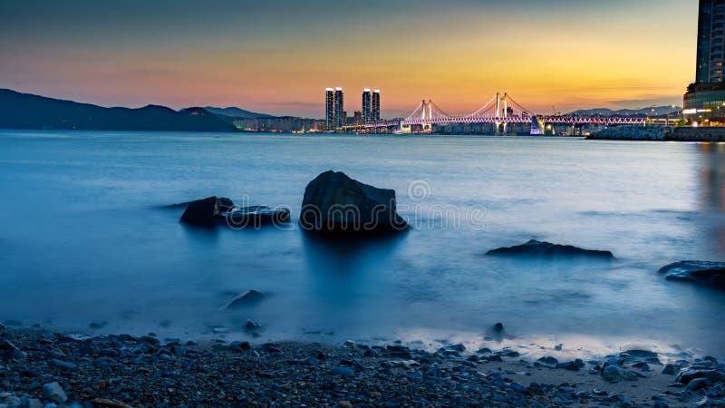 Gwangan bridge light up and beautiful twilight sky, sunset at Haeundae in Busan city. Busan, South Korea - Aug 8, 2018 : Gwangan bridge light up and beautiful stock photos