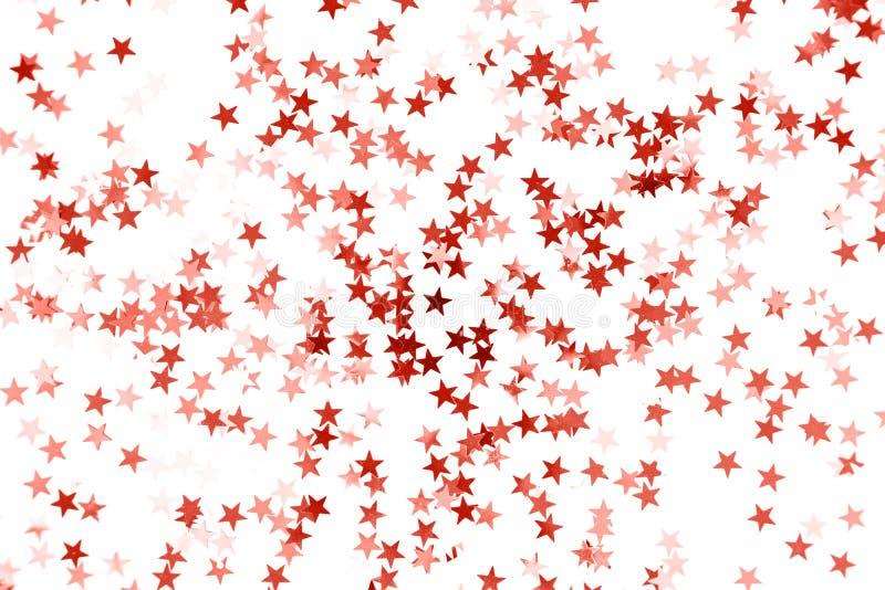 Gwiazda confetti tonujący Żywy Koralowy kolor odizolowywający na białym tle zdjęcia stock