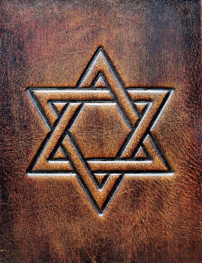 Gwiazda dawidowa, embossed starzejąca się brown skóra obraz stock
