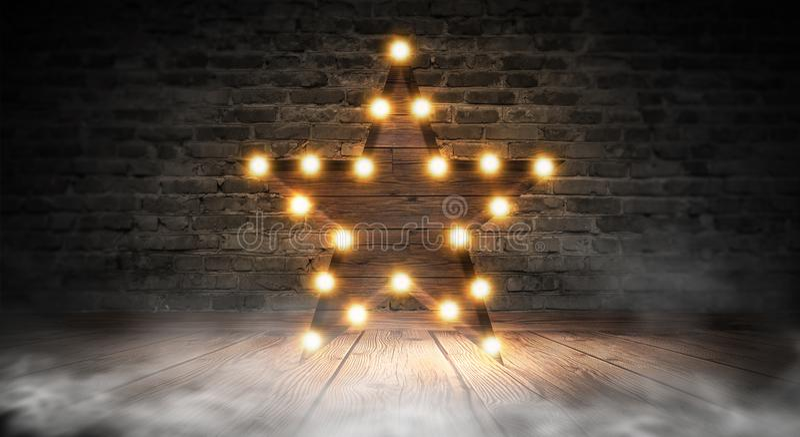 Gwiazdowa lampa na tle stary ściana z cegieł na drewnianej podłoga, zaświeca, światła, światła, świecenie, dym obraz royalty free