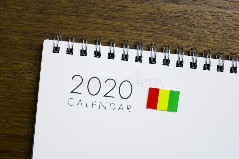 Gwinei flaga na 2020 kalendarzu obrazy royalty free