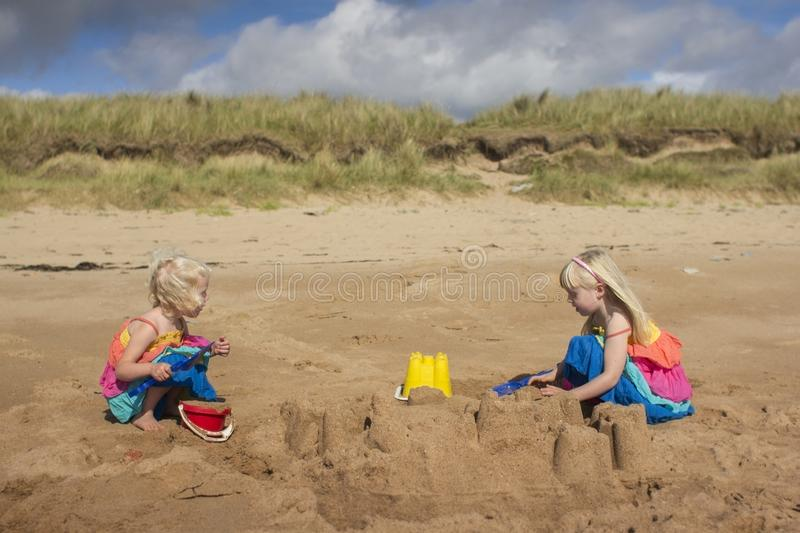 A young girls playing on the beach on a summers day stock photos