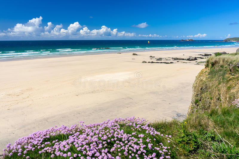 Gwithian Cornwall England UK. The beautiful golden sandy beach at Gwithian with Godrevy in the distance Cornwall England UK Europe stock photography