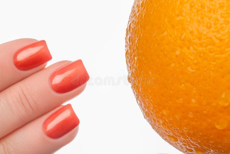 gwoździa pomarańcze połysk zdjęcia royalty free