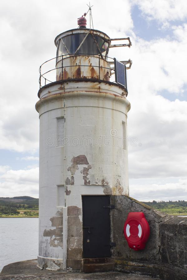 The lighthouse in Loch Fyne. The Light house at Ardrishag, Loch Fyne, Crinan Canal harbour on the coast of Argyle in Scottland on a summers day royalty free stock photos