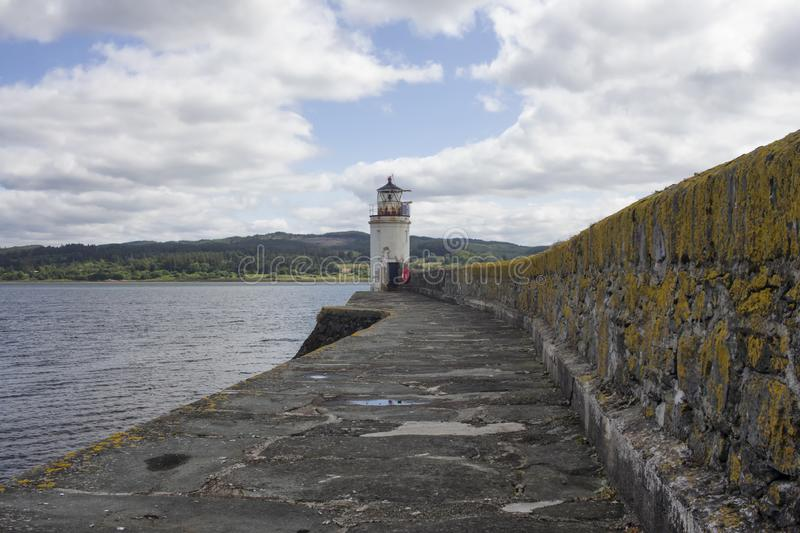 The lighthouse in Loch Fyne. The Light house at Ardrishag, Loch Fyne, Crinan Canal harbour on the coast of Argyle in Scottland on a summers day stock photos