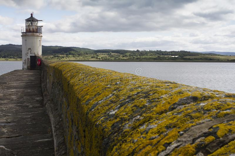 The lighthouse in Loch Fyne. The Light house at Ardrishag, Loch Fyne, Crinan Canal harbour on the coast of Argyle in Scottland on a summers day stock image