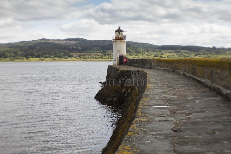 The lighthouse in Loch Fyne. The Light house at Ardrishag, Loch Fyne, Crinan Canal harbour on the coast of Argyle in Scottland on a summers day royalty free stock photo