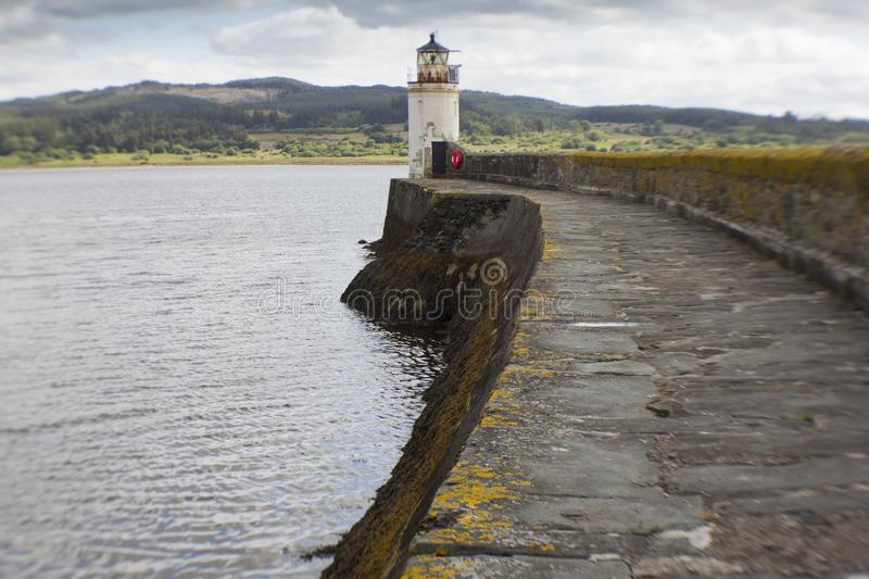 The lighthouse in Loch Fyne. The Light house at Ardrishag, Loch Fyne, Crinan Canal harbour on the coast of Argyle in Scottland on a summers day stock images