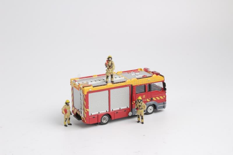 gyckel av diagramet av en brandman och en lastbil arkivfoton