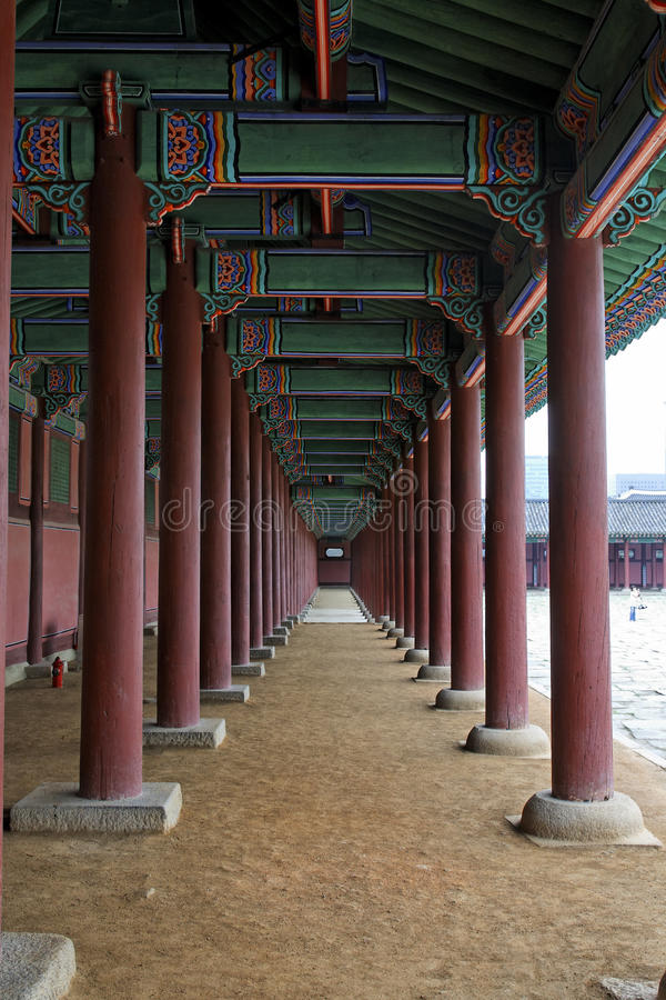 Gyeonbokgung Palace Porch. Looking down the row of pillars surrounding the entrance plaza at Gyeonbokgung Palace in Seoul, South Korea royalty free stock photos