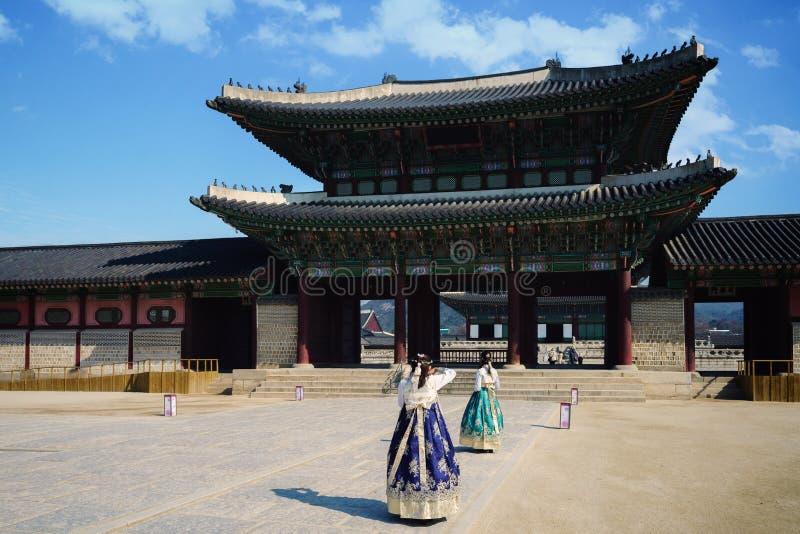 Gyeongbokgung Palace. Female traveler in korean national dress or Hanbok traveling into the Gyeongbokgung Palace, Seoul South Korea stock photo