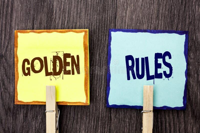 Gyllene regler för ordhandstiltext Affärsidé för planet Norm Policy Statement som för avsikt för regleringsprincipkärna är skrift royaltyfri fotografi