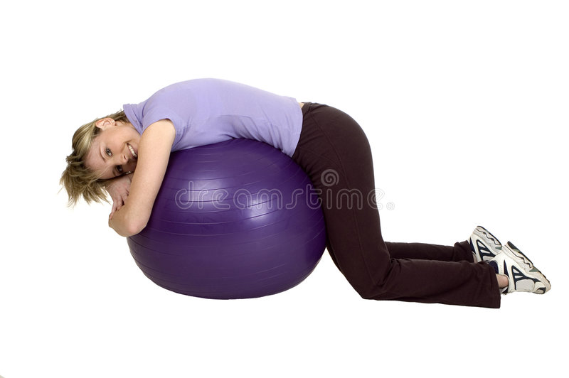Gym. Young women working out with gym ball stock photo
