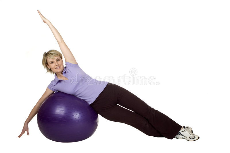 Gym. Young women working out with gym ball stock images