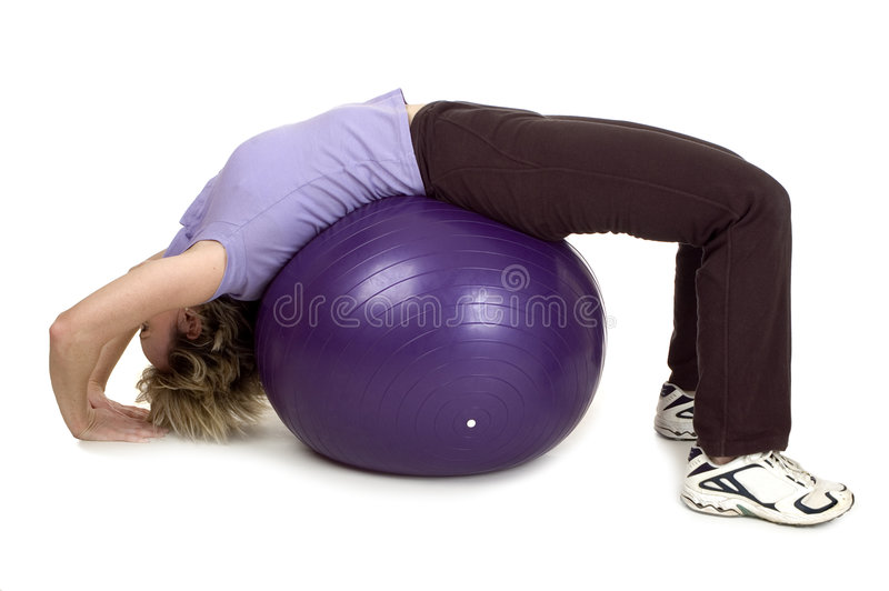 Gym. Young women working out with gym ball stock photography