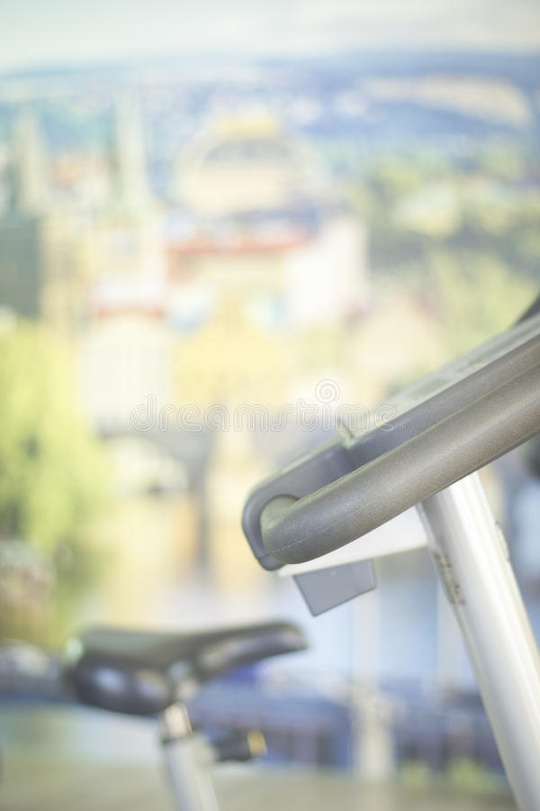 Gym bike exercise cycle machine. For static indoor cycling in fitness studio stock photo