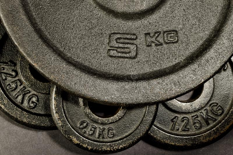 Gym dumbbells. Fitness, body building, equipment, background with weights stock images