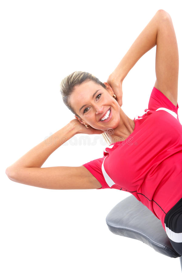 Gym & Fitness. Smiling woman working out. Isolated over white background stock photography