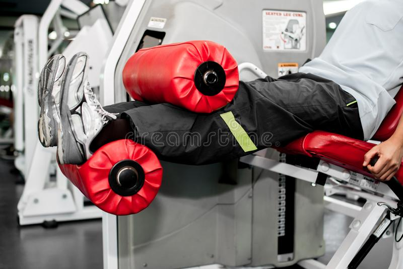 Gym fitness club indoor with young girl training weights stock photography