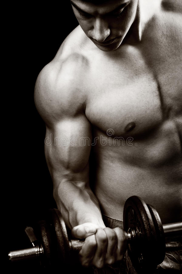 Gym And Fitness Concept - Bodybuilder And Dumbbell Royalty Free Stock Image