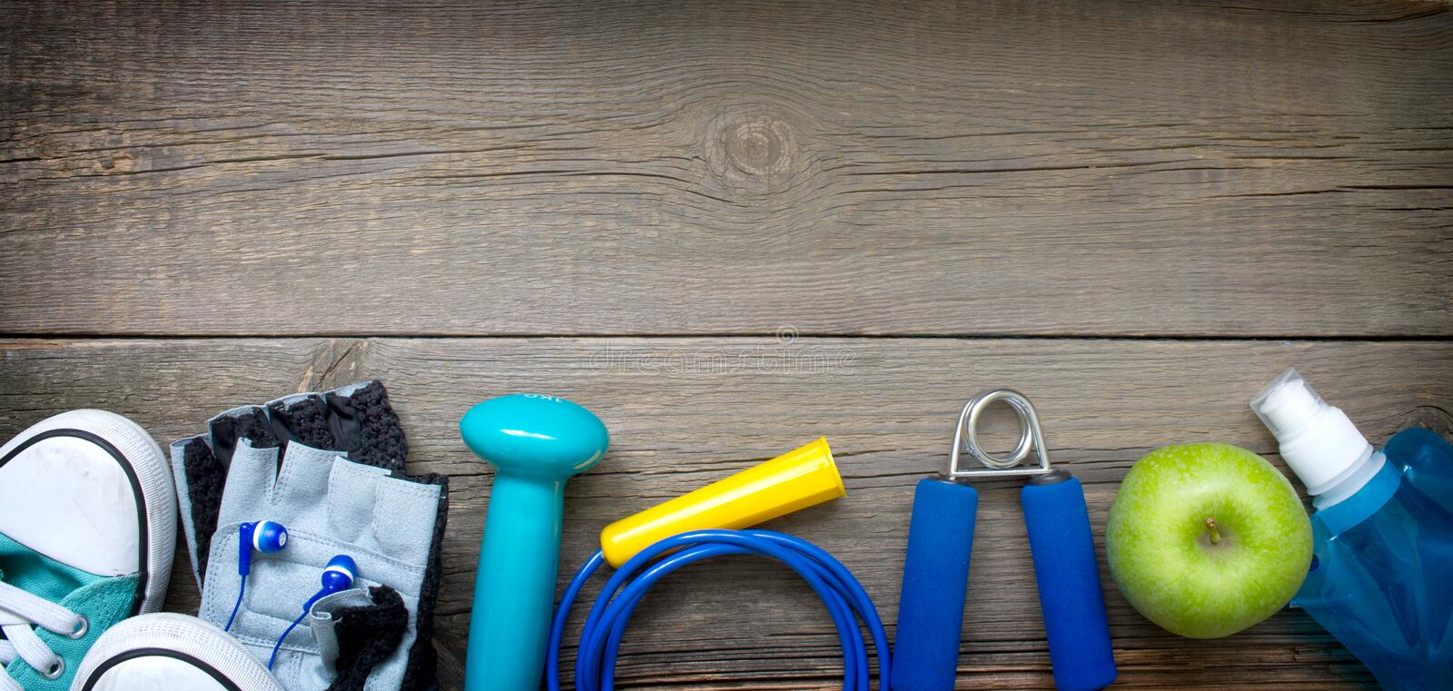 Gym fitness healthy lifestyle banner background concept on wooden board stock image