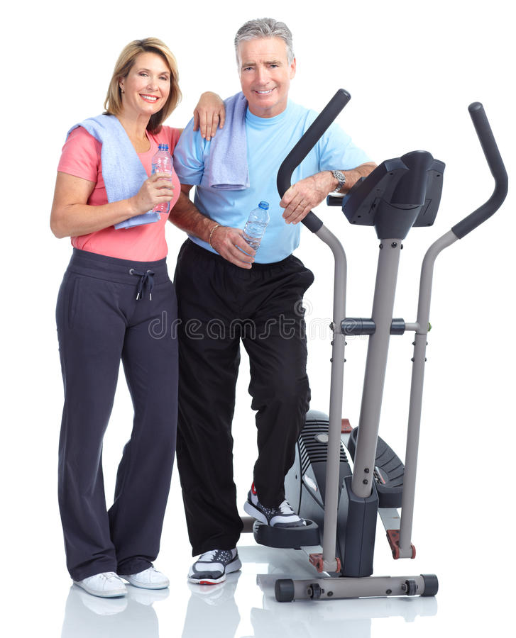 Gym, Fitness, healthy lifestyle. Senior healthy fitness couple. Over white background royalty free stock photography