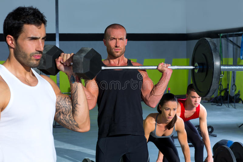 Download Gym Group With Weight Lifting Bar Crossfit Workout Stock Image - Image: 28359285