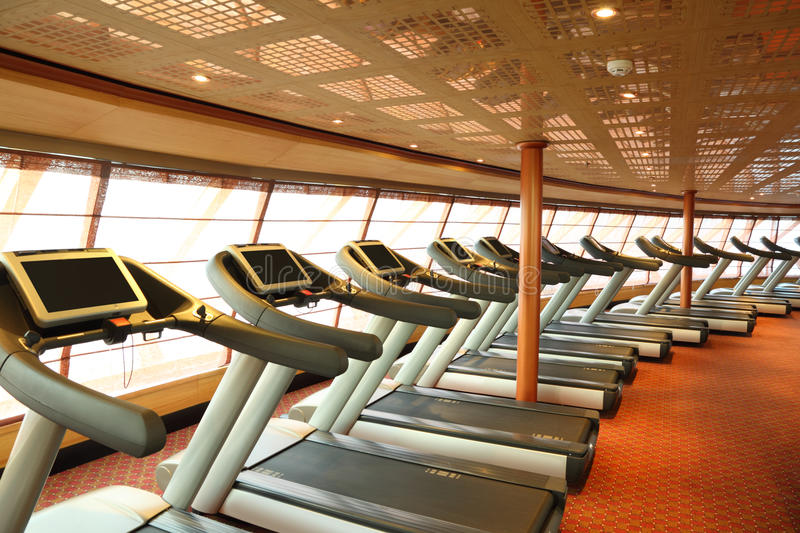 Gym hall with treadmills in cruise ship stock photos