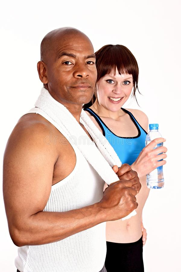 Gym. Image of a women in a health club with her personal trainer stock photo