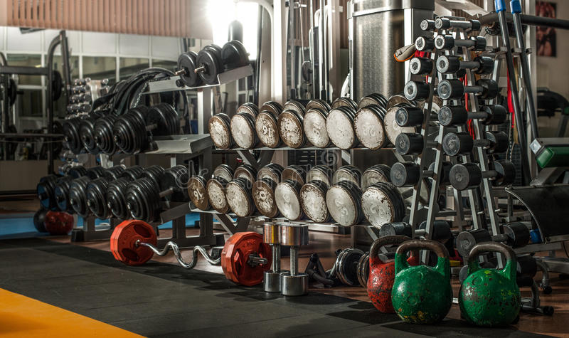 Gym interior. Gym indoor interior with dumbbells; horizontal photo stock photography