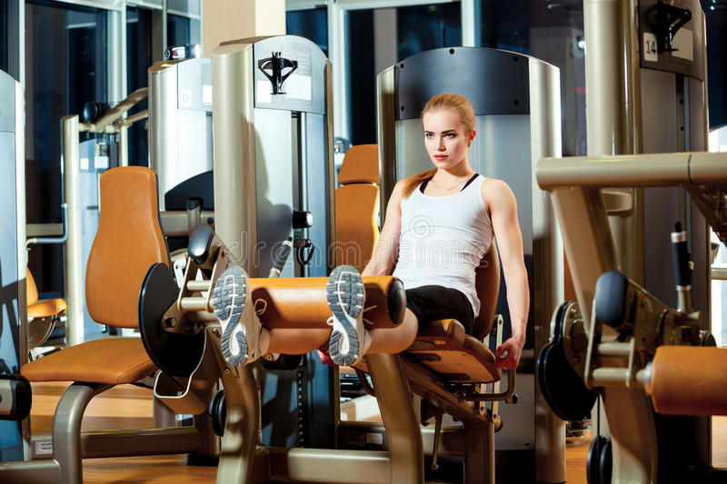 Gym leg extension exercise workout woman indoor stock images