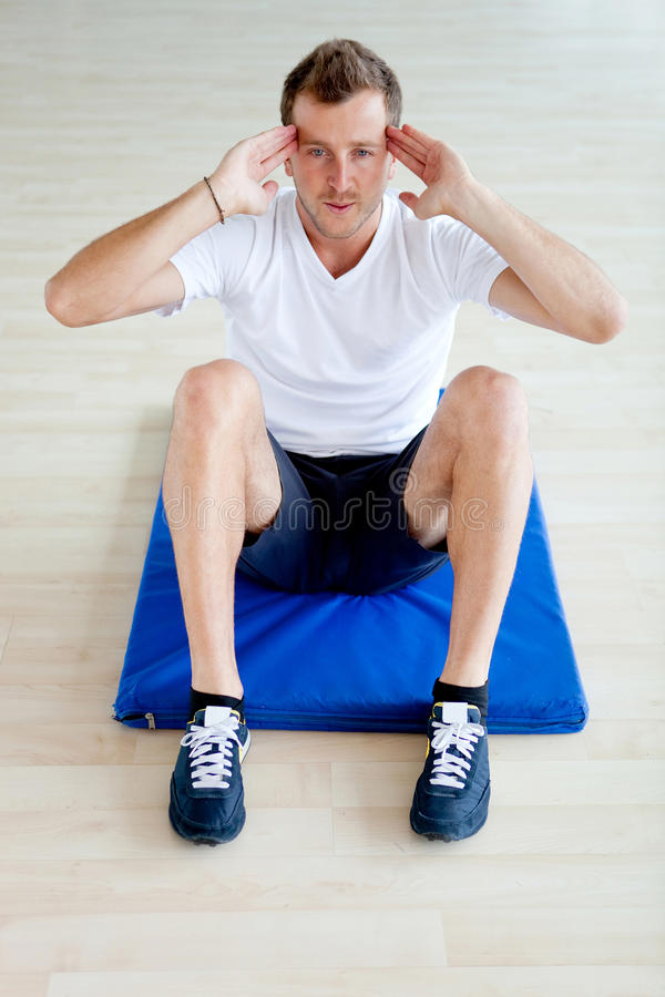 Download Gym man doing abs stock photo. Image of people, exercises - 21564080