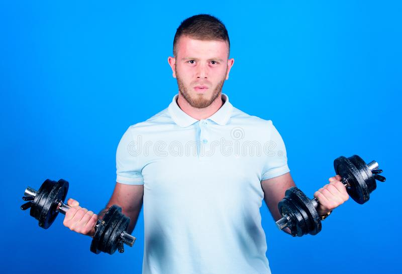 Gym membership. Workout fitness sport. Gym concept. Healthy mind in healthy body. Muscular man exercising with dumbbells. Sportsman strong biceps triceps stock images