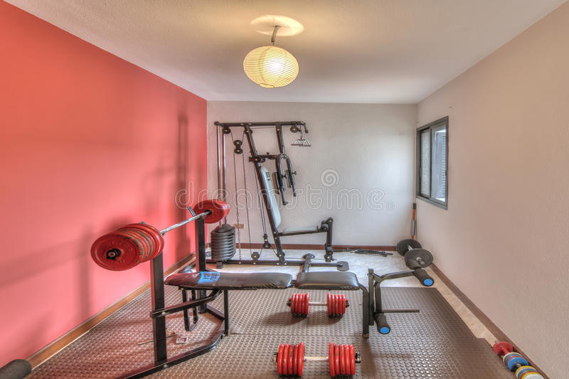 GYM in the modern villa. Gym with rose walls in the modern villa royalty free stock photo