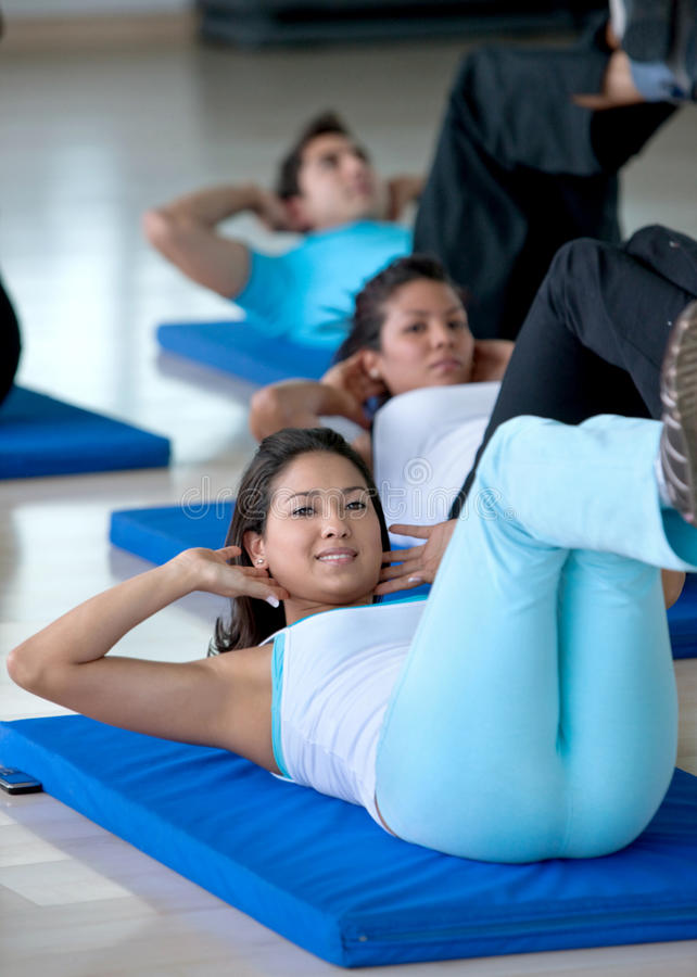 Download Gym People Exercising Their Abs Stock Photo - Image: 11156254