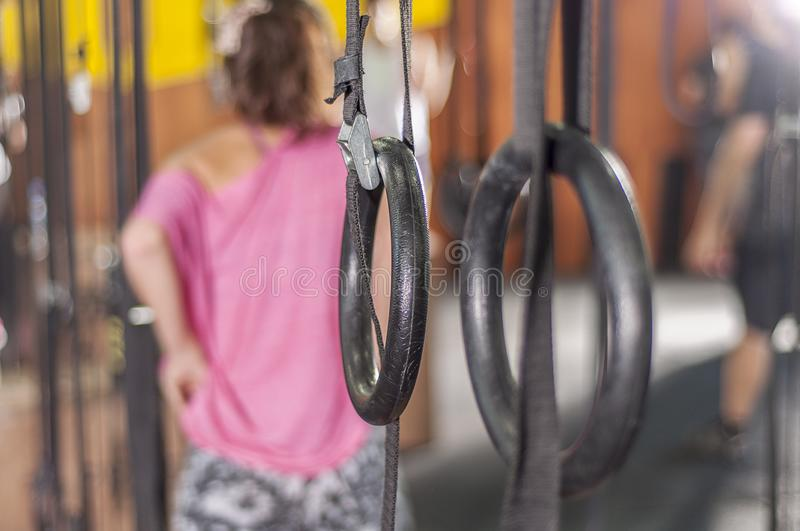 Gym rings in the crossfit box. The traditional gym rings to practice ring row exercise in the crossfit box royalty free stock image
